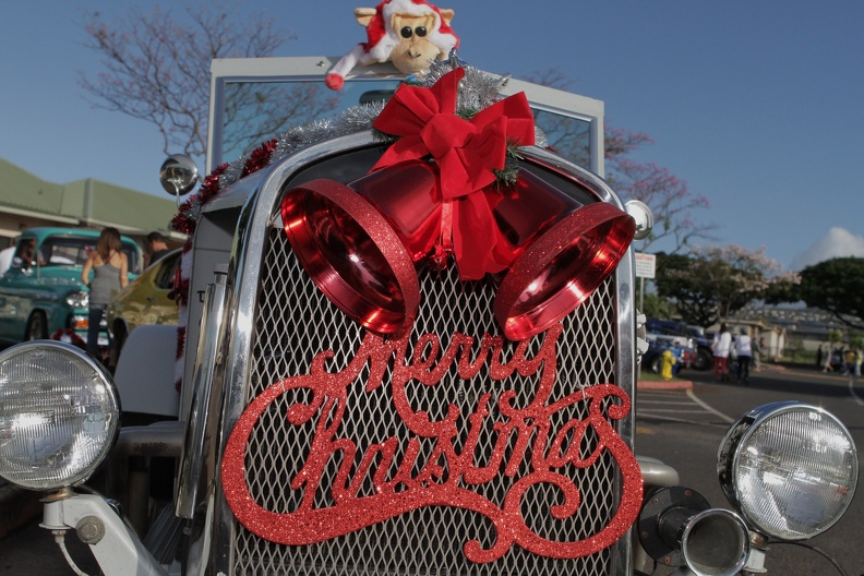 Photo of a Merry Christmas decal on a classic car decorated for Christmas.